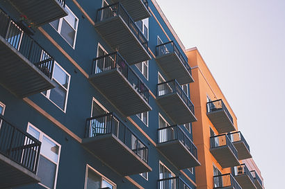 Apartment Building for a passive real estate investing training program and mentor