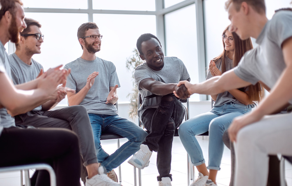 Men participate in group therapy in Denver Colorado.Catalyss Counseling provides treatment for depression and anxiety in Colorado through online therapy and in person counseling in the Denver area 80209 and 80210