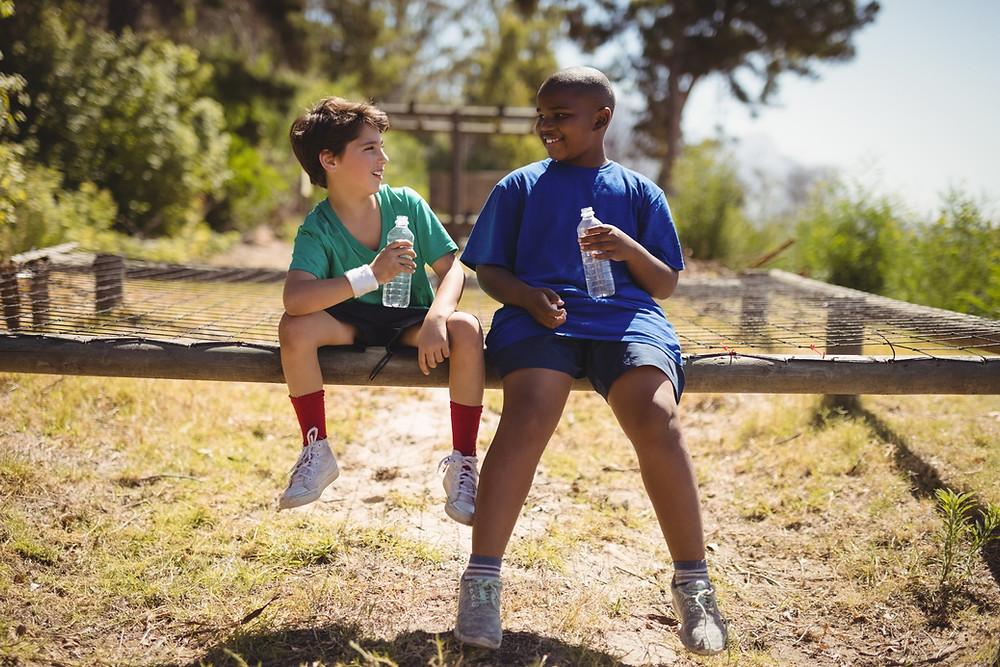 2 friends drinking Hydra-guard sports drink