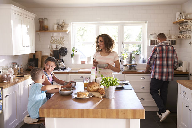 Family keeping odors out of the kitchen at breakfast