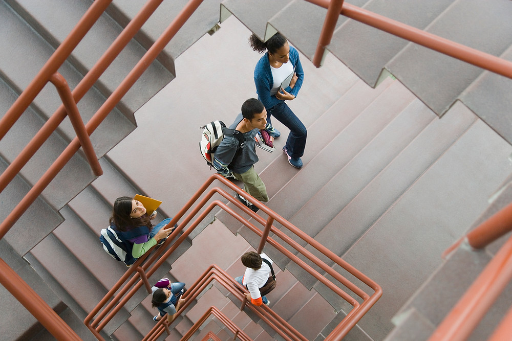 College students walking up a long flight of stairs.