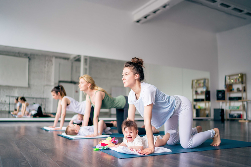 Three young women are training with babies
