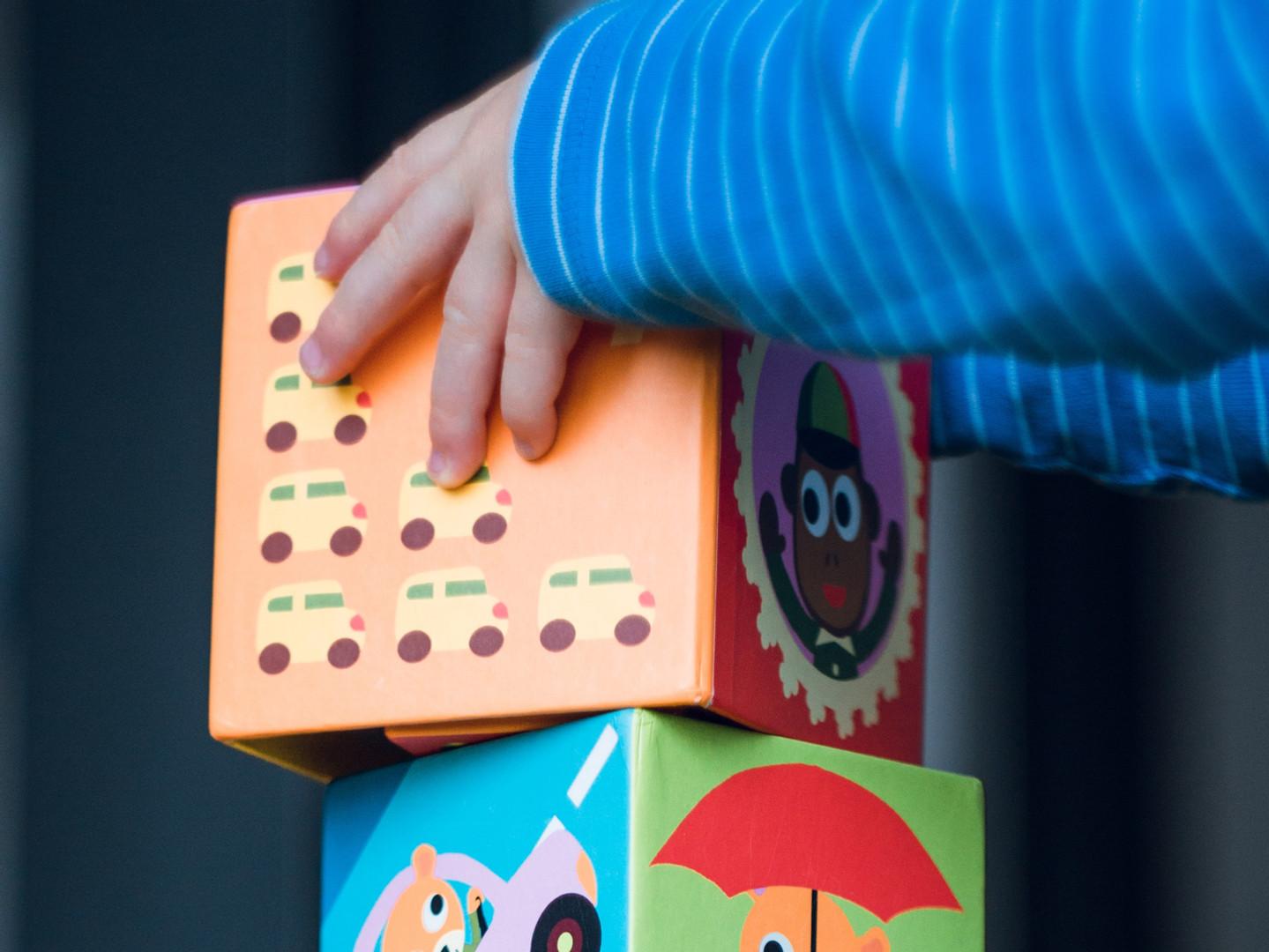 Kid Piling Blocks