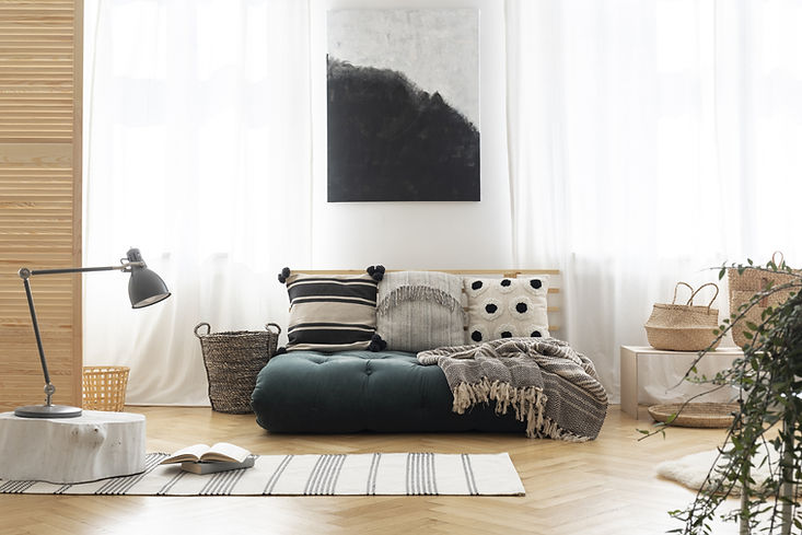 Soft sofa, neutral colours, natural textures, plants, artwork, relaxing room