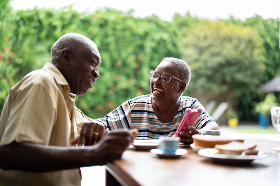 Two Seniors Laughing Over Lunch