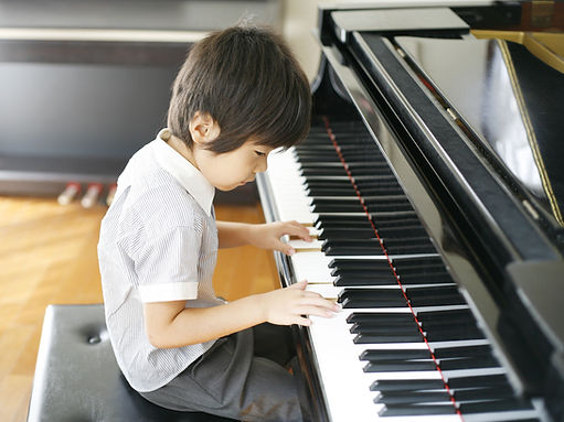 Young Boy Playing the Piano