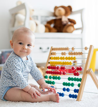 Baby Playing with Abacus