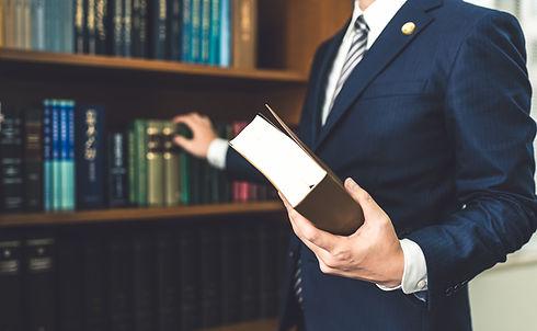 本を持った税理士