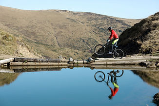 Reflection of Cyclist on Water