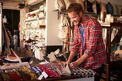 A man looking at goods at a store