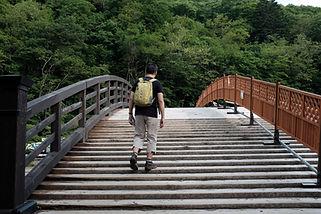 Man Walking on a Bridge