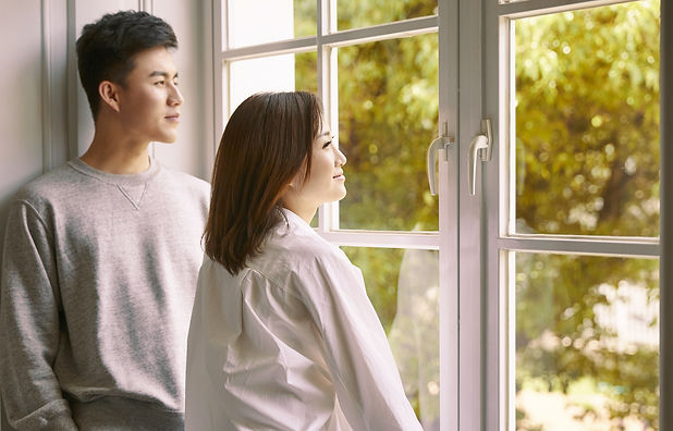 Couple Standing By Window