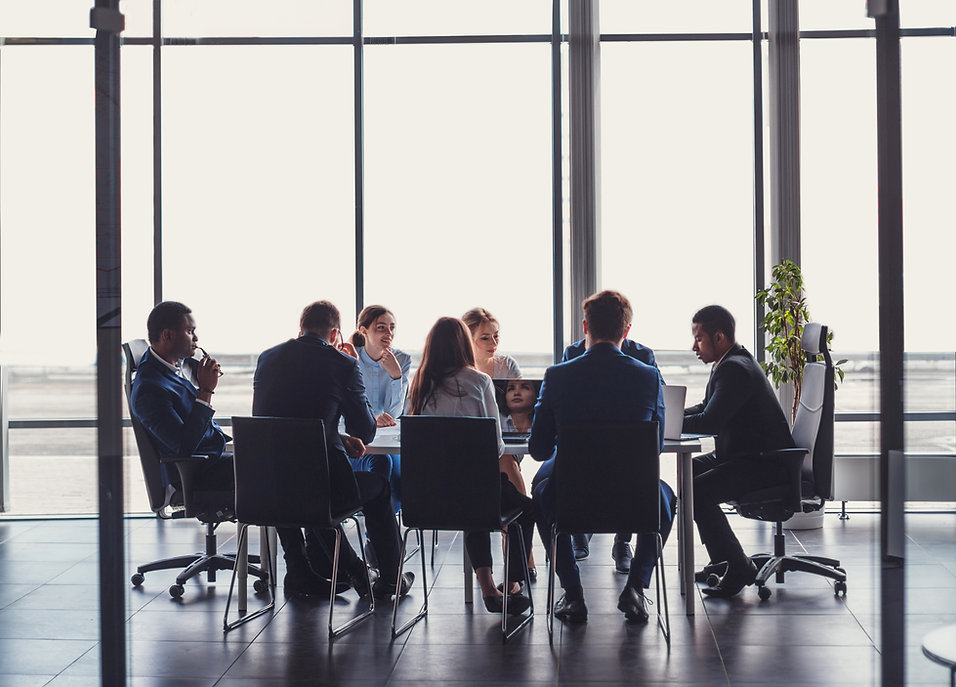 team of business attorneys meeting with client