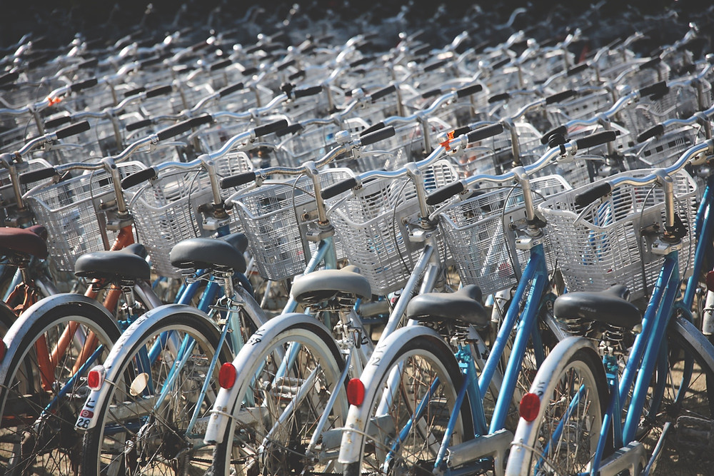 Hundred of traditional bikes lined up