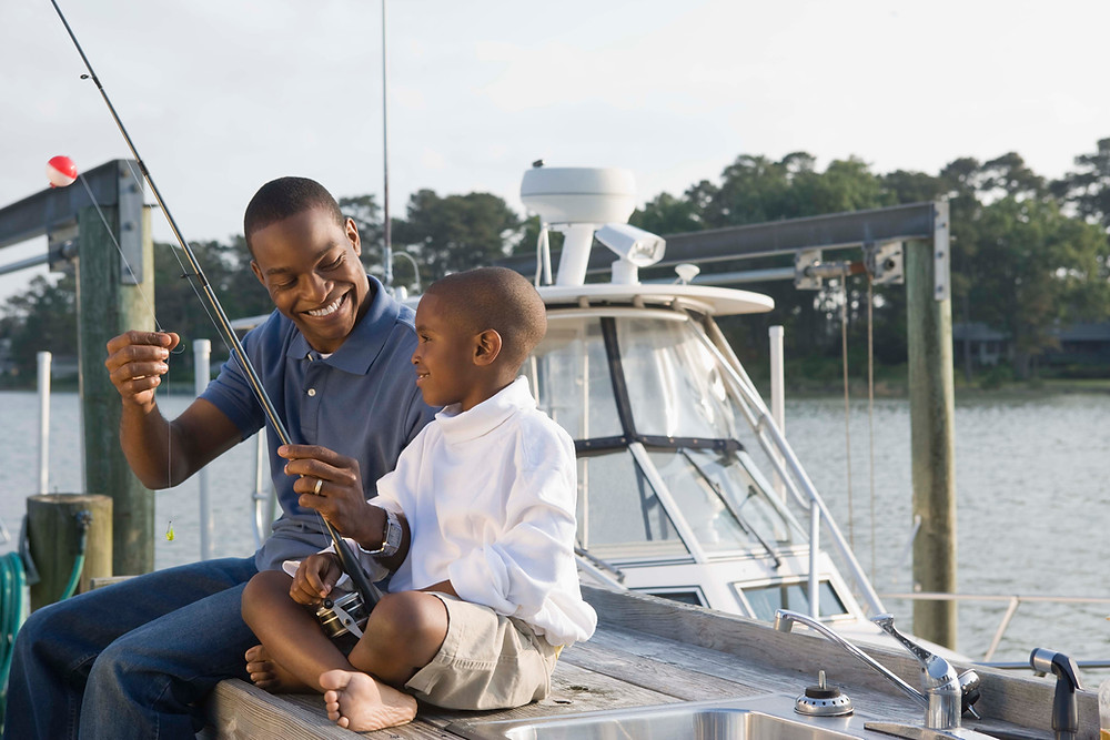 Father and son fishing. Marble Wellness has therapy for men in St. Louis and also does counseling for men in Chicago, IL. Reach out today to start your therapy journey!