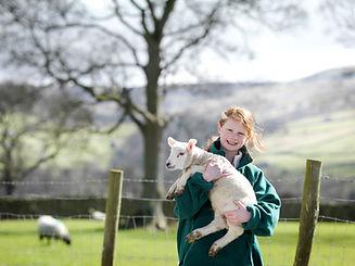 Girl Holding Lamb
