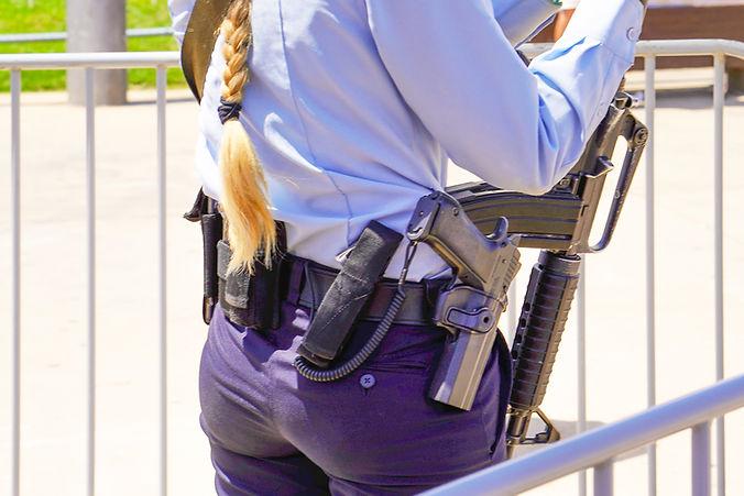 Policewoman with Guns