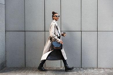 A woman in a coat walking