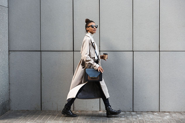 A woman in a coat walking