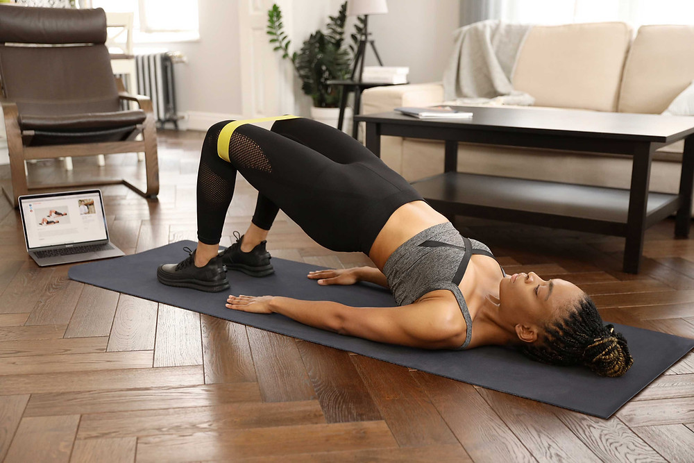woman practicing pilates at home