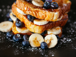 OVERNIGHT FRENCH TOAST SERVED WITH MAPLE SYRUP