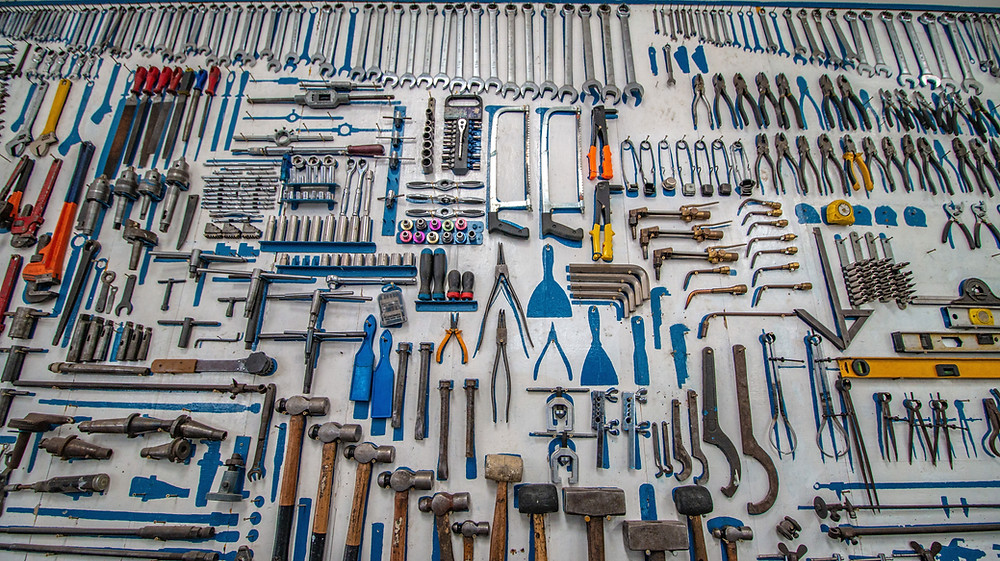 a wall of woodworking tools