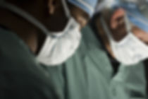 Doctors perform surgery on injured client