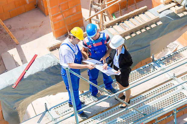 Builders reviewing asbestos survey plans