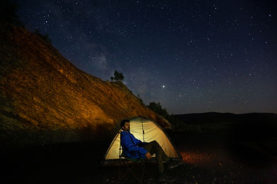 Camper Outside a Tent