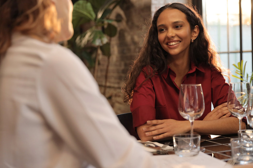 Dinner conversation between 2 women