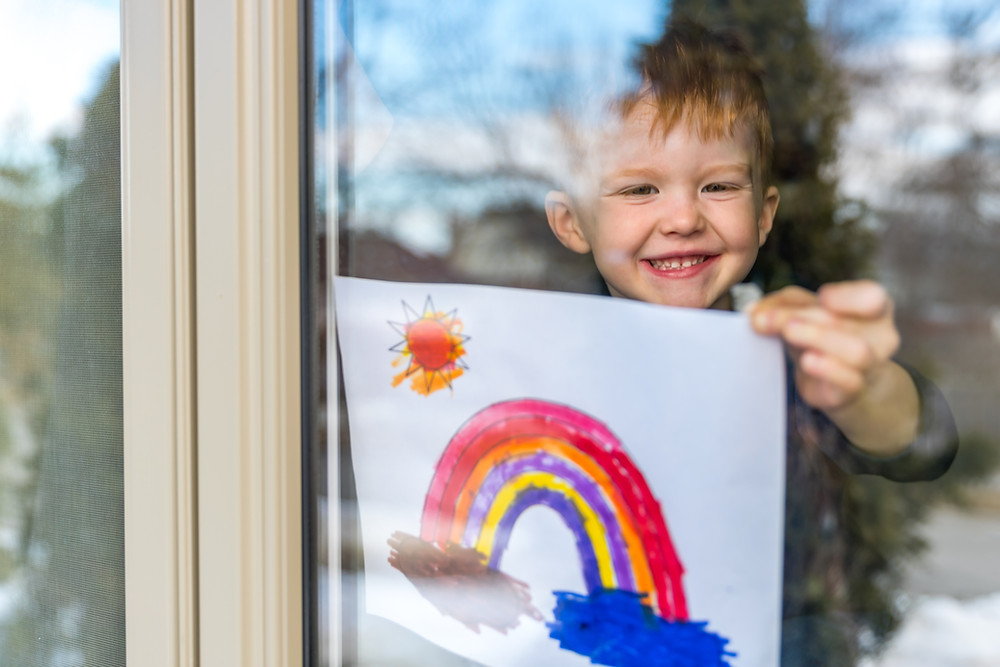 Happy boy with rainbow picture and Peninsula Family Coaching