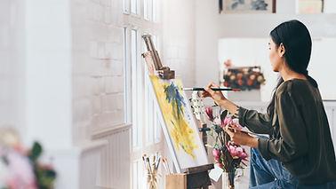 Artist Painting in Studio