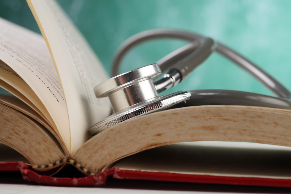open book with a stethoscope