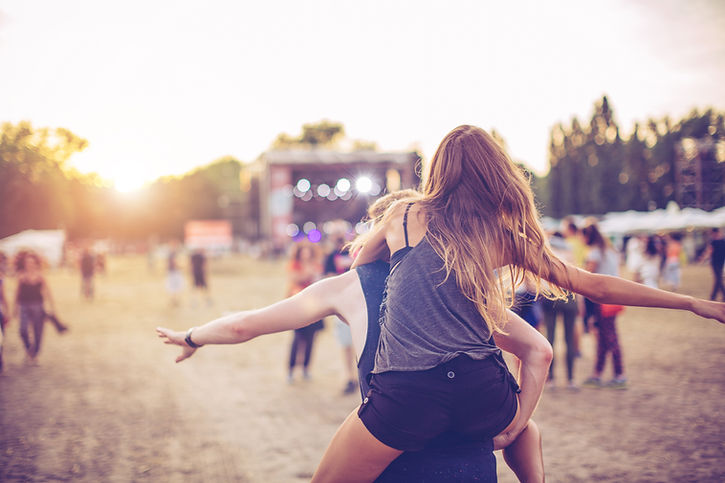 Couple at a Music Festival heading into main stage for the next act