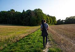 Man with Guitar Walking in a Fields