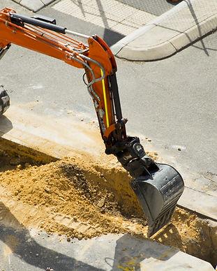 Gräva på byggarbetsplatsen
