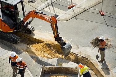 Bobcat digging at a construction site