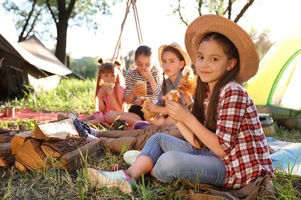 Children having a picnic while camping