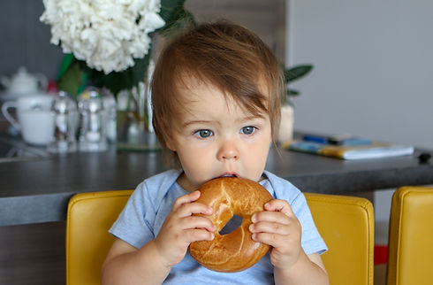 Baby Eating a Bagel