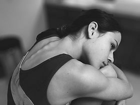 Gymnast Hugging Knees