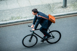 Man riding his road bicycle on the stree