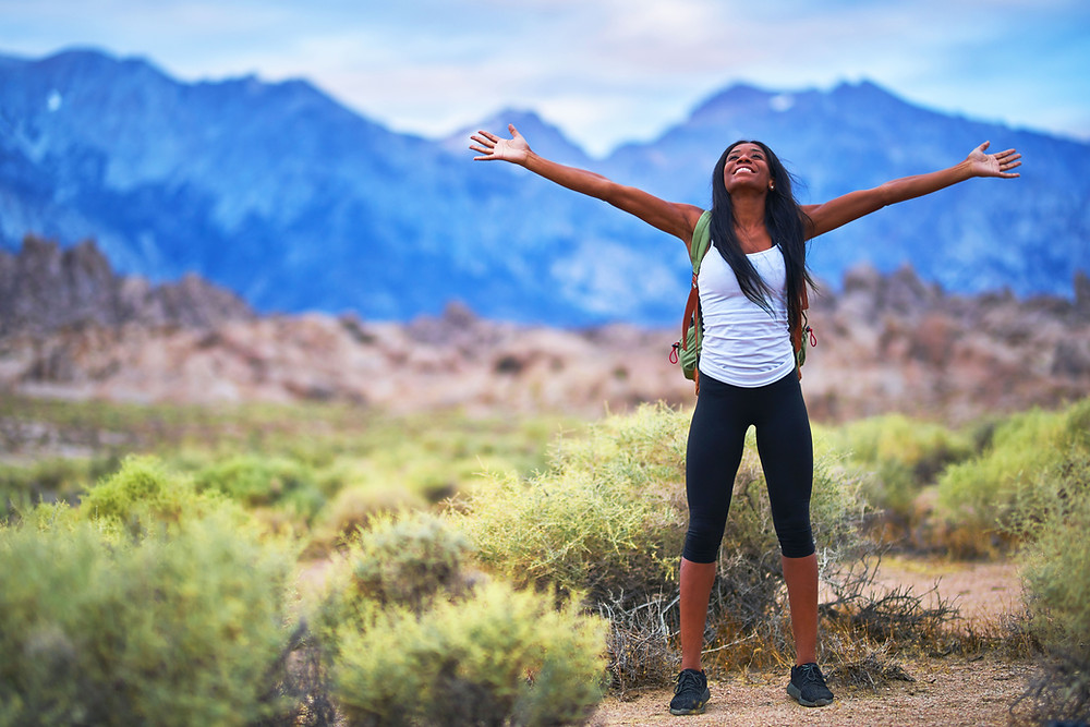 young lady happy nature mountains