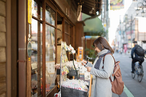 Woman Browsing Outside a Store