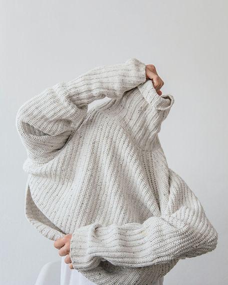 Putting on Sweater