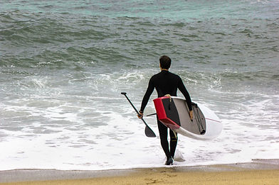 Stand Up Paddleboard on ocean beach for lesson