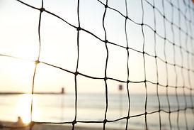 Tennis net and calm skies