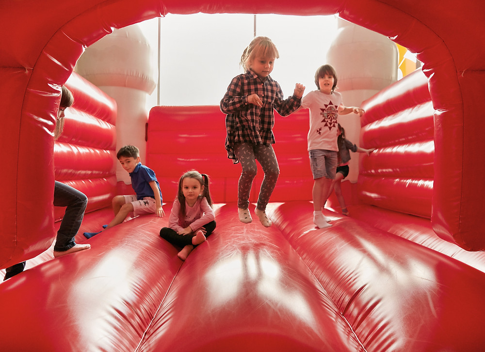 Children bouncing in a bouncy house
