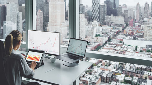 A woman at the office overlooking the city skyline