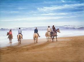 Horseback Riders on the Beach