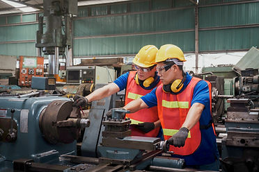 Two Technicians Working On Machine